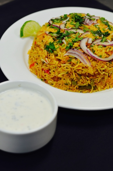 Vegetable Biryani is the Indian version of fried rice, every bite is different and flavorful.