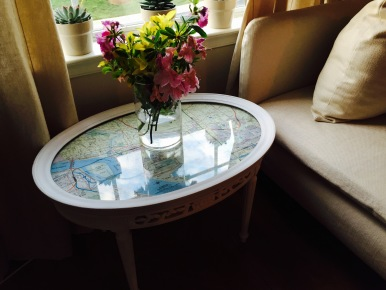 Vintage serving table with glass top $40